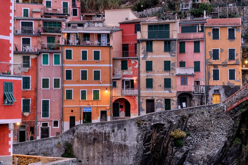 Colorful houses along the marina in Riomaggiore, Cinque Terre, Italy