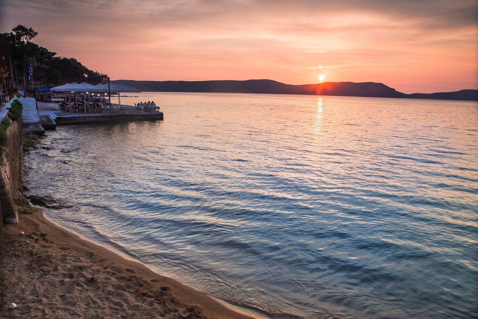 A beachside restaurant at sunset in Pylos, Greece
