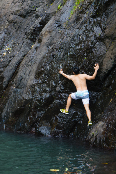 Trying to climb the waterfall like the locals...