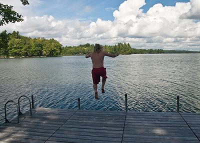 Jonathan jumps in Ellis Pond.