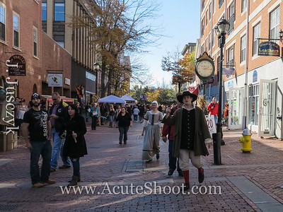 Street in Salem with actors putting on a sales pitch to their show.