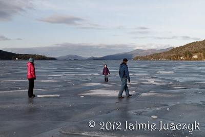 Daring to walk on the frozen end of the lake. Here there were a couple inches of ice underneath them.