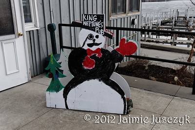 The kids paint snowmen for local businesses around the Village for the Winter Carnival.