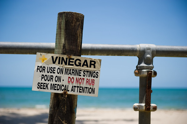 Australia has MANY signs.... this particular one was for a vinegar station in case you got stung by a jelly.