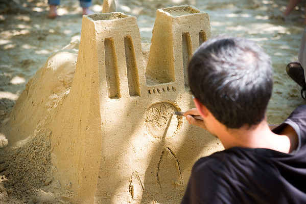 One of the locals creating Notre Dame out of sand