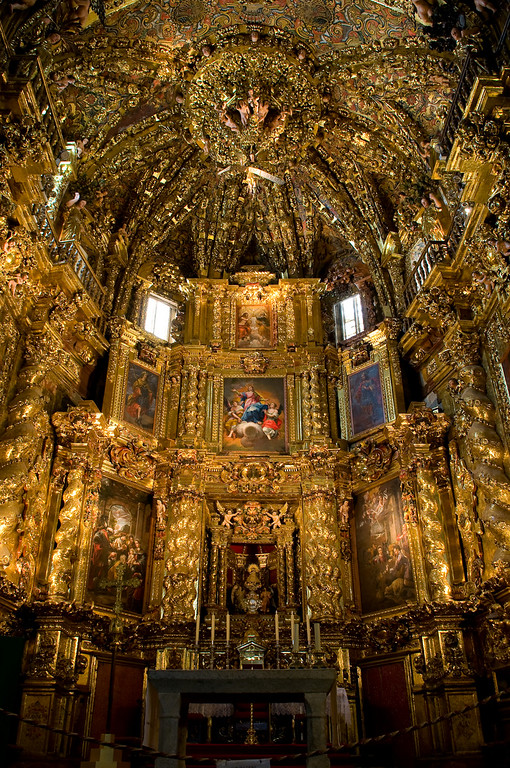 Inside, the high altar and sanctuary is decorated in lavish baroque style, plated in gold.