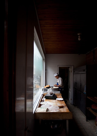 A Uyghur cook was preparing food in a Uyghur restaurant in Urumqi.
