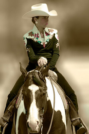 A cowgirl in a horse show