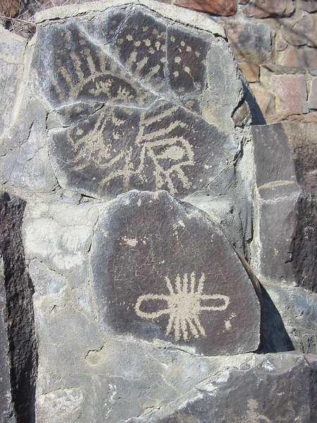 Thousands of petroglyphs were found by the river before the building of the local dam.  Some are preserved here