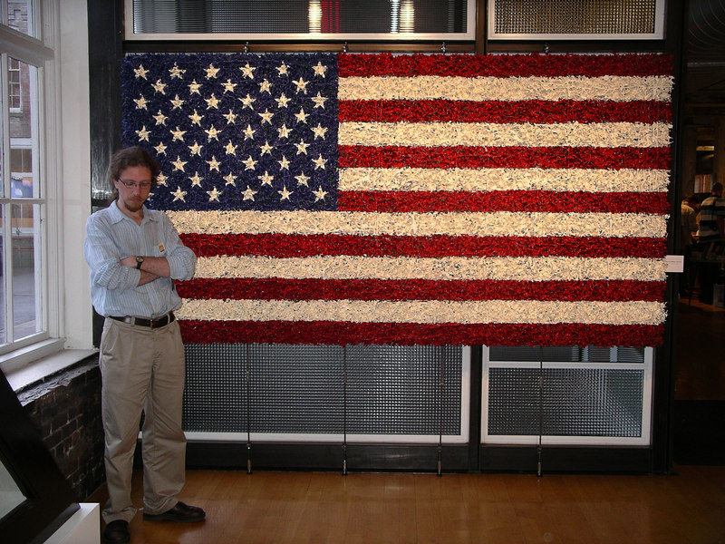 Me in front of another flag made by David Cole from a few thousand plastic toy soldiers and than painted.  And no, I'm not asleep.