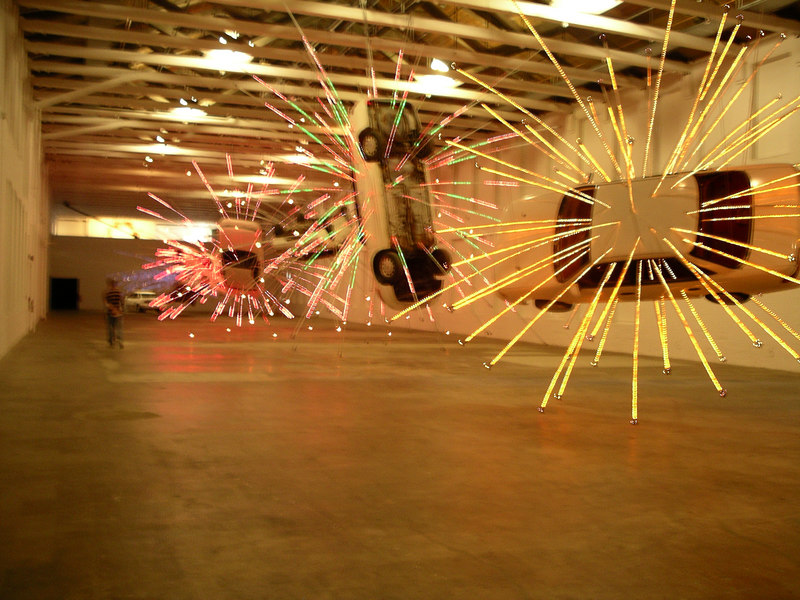 Cai Guo-Qiang: Inopportune. Stills of a car exploding.  Building 5 of MassMoCA is one of the largest display spaces that I have seen, 2 stories high and about 200 ft long.