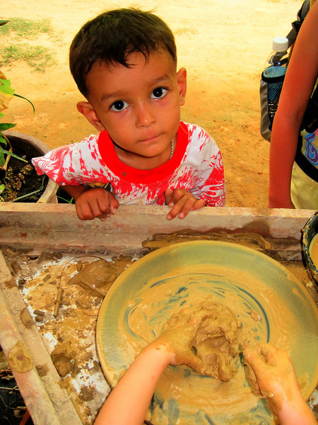 Little boy in Cambodia who was watching my niece on a pottery wheel.