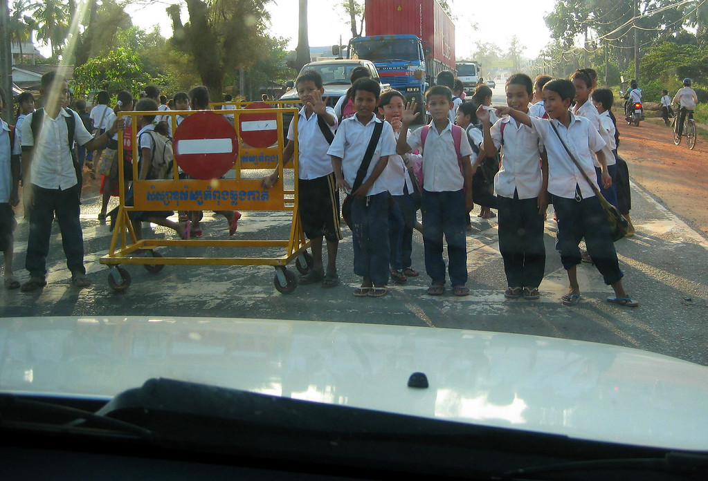 On the way back to Phnom Penh. Boys are put in the middle of the highway. These guys took thier job seriously until....