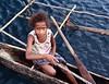 A Young Village Girl Who Had Just Sold a Bunch of Bananas to the Dive Boat