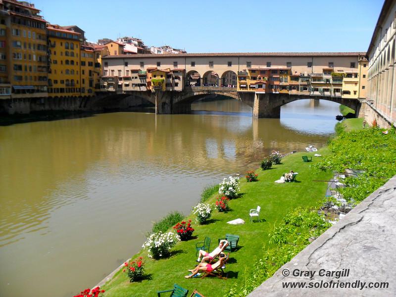 Ponte Vecchio and sunbathers