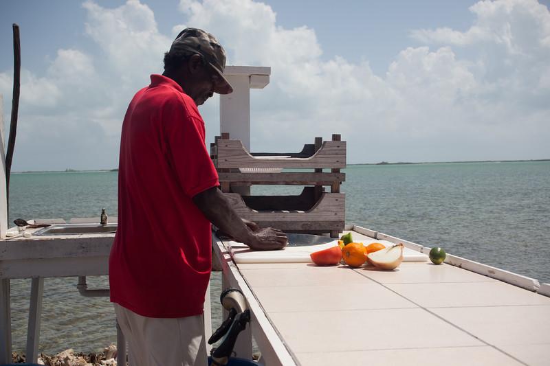 Making Conch salad at Seaside Village