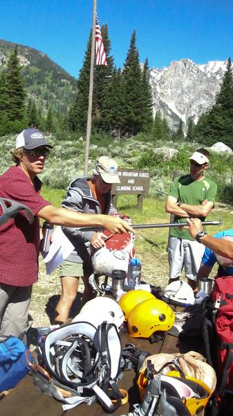 Eric distributes ice axes. (Photo: Kyle Fernley)