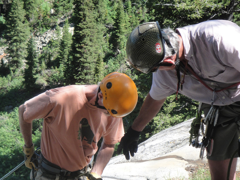 After several multi-pitch practice climbs we were ready for the next skill - rappelling. Here Renny checks out Lou's knots and makes sure the rappel device is properly attached to his harness.