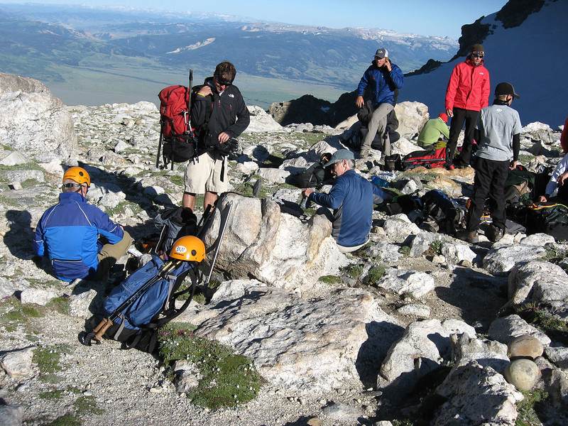Finally we reached the objective for the day, the Lower Saddle, a narrow ridge in between the Middle Teton and Grand Teton. Exum maintains a camp here for climbers. It was windy and cool, so the first thing to do was put on warm clothes.