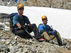 Lou and Rob rest while waiting for the climbers above to join the group.