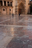 The marble pavement is polished after many years of foot traffic.