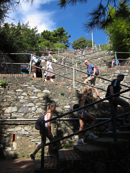 Corniglia is perched on a cliff above the sea, and to get to it from the train station you either have to take a bus or climb the 380 steps to the village.