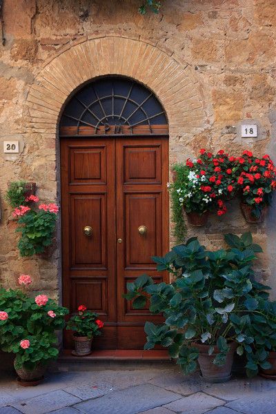 . . . which were all decorated with perfectly tended geraniums, impatiens, begonias, and ivies.