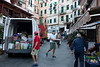 In the early morning the streets were crowded with delivery trucks . . .