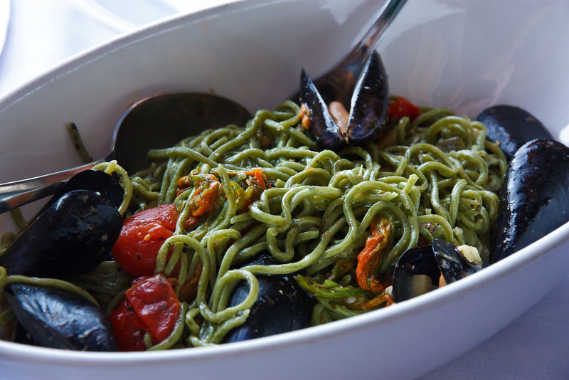 Kathy had pici pasta (which later in the trip we learned how to make) with squash blossoms, zucchini, tomatoes, and mussels . . .