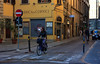 . . . riding to work through the narrow streets.