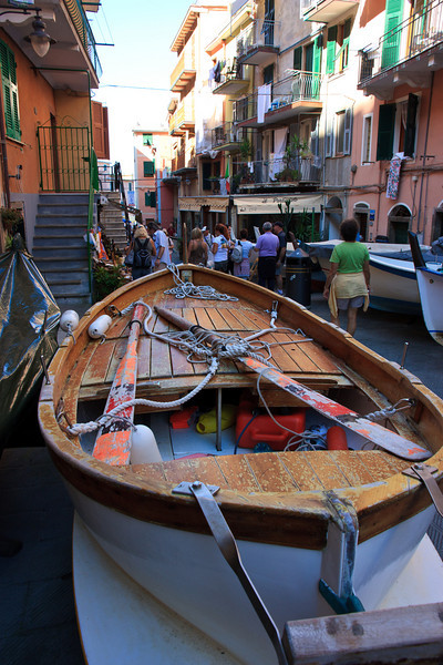 The main street of Manarola  is lined with small fishing boats on small trailers, which the owners wheel down to the boat ramp at the end of the village when they want to go fishing. The villages of Cinque Terre used to subsist on fishing; now they subsist on tourism.