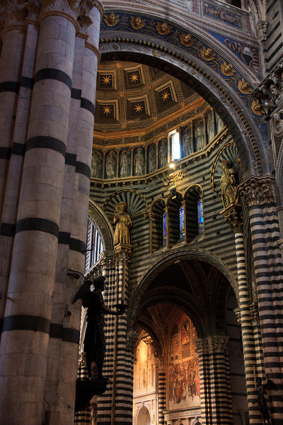 The striped columns and gilded dome of the cathedral are stunning.