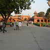 Agra: This is just inside the grounds of the Taj, but the Taj itself is not in view yet. The gate in the center distance is the entry from the street. Walk through there and towards foreground. See next photo for continuation.