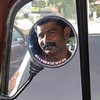 Chennai: reflection of my autorickshaw driver taking me to the airport as I was getting ready to leave