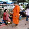 tak bat - the ritual of giving food to the monks