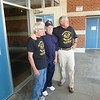 Dennis Nelson, Jim Hock, and Don Winter at the school entrance