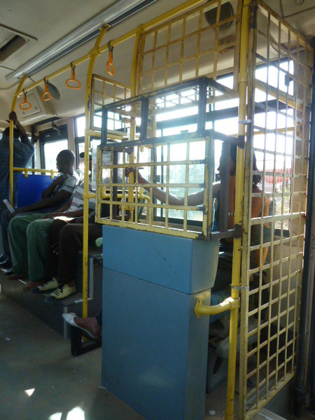 fare collector in her cage on the bus