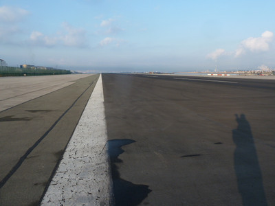 crossing the airport runway to walk into town