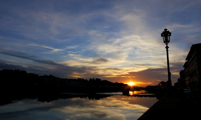 Sun setting over the Arno river.