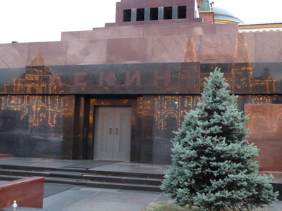 lights of GUM reflected off of Lenin's tomb