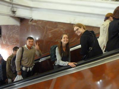 Sergey, Katie, and Johanna on the Moscow Metro escalator