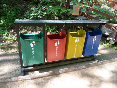 recycling and garbage containers in park