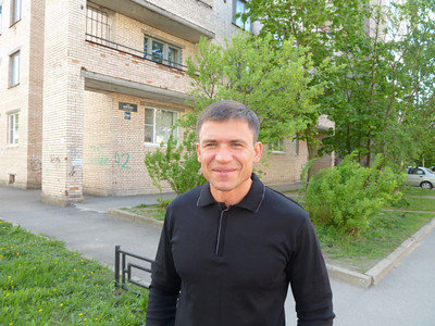 Sergey, our amazingly delightful host, in front of his apartment building