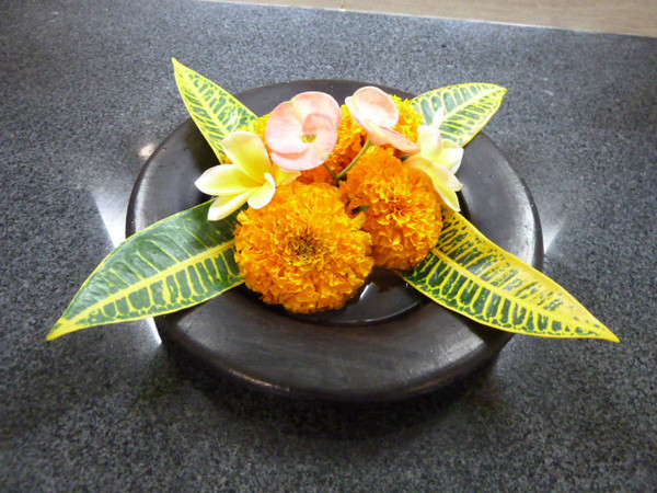 Denpasar<br /> Ngurah Rai International Airport<br /> <br /> Flowers are important in Bali. They are everywhere. These were on the sink counter in the men's room at the airport.