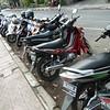 Ubud<br /> street scene with everpresent motorbikes