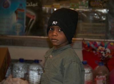 Young Boy at a Shop