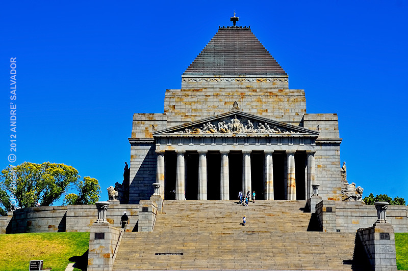"""Once a year, on 11 November at 11 a.m. (Remembrance Day), a ray of sunlight shines through an aperture in the roof to light up the word """"Love"""" in the inscription. Beneath the sanctuary lies the crypt, which contains a bronze statue of a soldier father and son, and panels listing every unit of the Australian Imperial Force. In 2002-2003 a Visitor Centre was built within the foundations of the Shrine. The visitor centre incorporates an education centre (including three classrooms and meeting room), an audio-visual centre, gallery space, a retail shop and an administration office, as well the Hall of Columns (in which the Changi Flag is on display) Gallery of Medals, entry courtyard and Remembrance Garden. The walls of both the entry courtyard and Remembrance Garden have been built to complement the Ray of Light ceremony that takes place on 11 November of every year."""