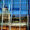 The Melbourne Museum's glass curtain wall reflecting the historic Royal Exhibition Building.