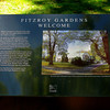 A marker for Fitzroy Gardens at it's main entrance. It reads:<br /> <br /> Fitzroy Gardens is haven on the edge of the city with many points of interests for visitors to enjoy.<br /> <br /> Set aside as a public reserve in 1848, the 26 hectare site officially became Fitzroy Gardens in 1862. It is the City of Melbourne's premier garden, where different eras of Melbourne's history are represented both in the landscape and built features.<br /> <br /> In this immediate area is the Conservatory, with its colorful floral exhibitions, and the main pathway to Cook's cottage. Further exploration of the gardens will reveal magnificent tree avenues, fountains and fern gully, garden beds and extensive lawns.The Fairie's Tree, Model Tudor Village, and Scarred Tree may also be found here.<br /> <br /> Fitzroy Gardens was included on the Victorian Heritage Register in 1998.