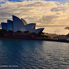 Another angle of view of the Sydney Opera House from our ship.<br /> <br /> The Sydney Opera House was made a UNESCO World Heritage Site on 28 June 2007.[2] It is one of the 20th century's most distinctive buildings and one of the most famous performing arts centres in the world.[citation needed]<br /> <br /> The Sydney Opera House is situated on Bennelong Point in Sydney Harbour, close to the Sydney Harbour Bridge. It sits at the northeastern tip of the Sydney central business district surrounded on three sides by the harbour (Sydney Cove and Farm Cove) and neighboured by the Royal Botanic Gardens.